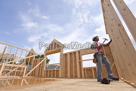 hispanic carpenter working on the upper