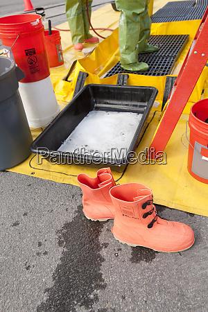 hazmat firefighter getting decontamination wash
