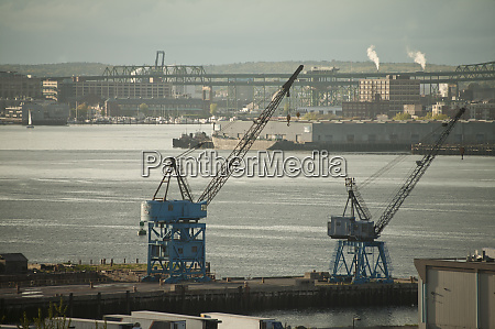 cranes at a harbor mystic river
