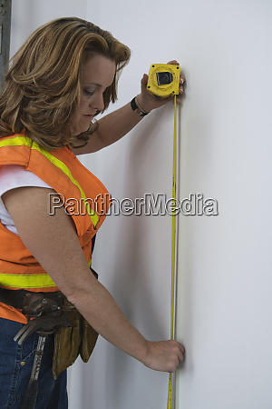 view of a woman using tape
