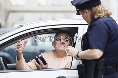 woman police officer checking drivers license