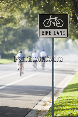 bicycle lane signboard at the roadside