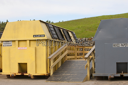 two recycling containers with access ramp