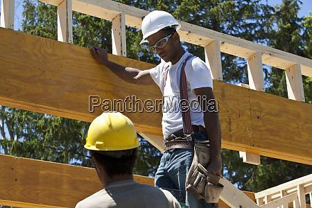carpenters putting up beams