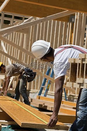 carpenters measuring beams