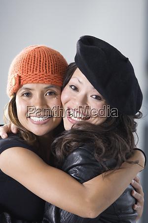 portrait of mid adult women embracing