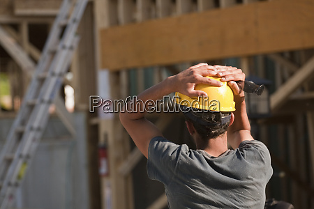 construction worker contemplating