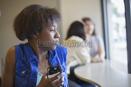 woman with learning disability listening to