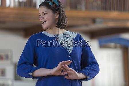 girl with traumatic brain injury performing
