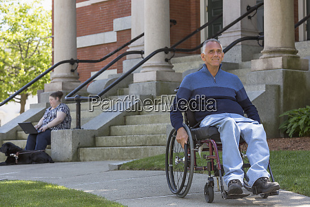 man with spinal cord injury sitting