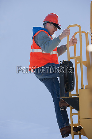 engineer climbing the ladder of earth