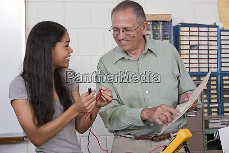 engineering professor showing a resistor value