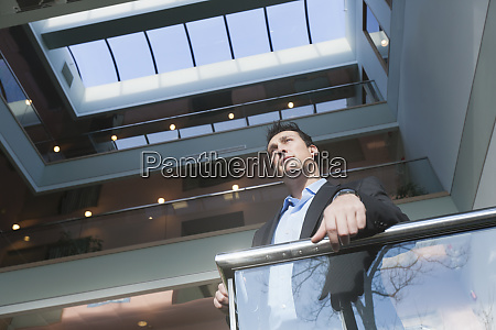 businessman standing on the stairwell of