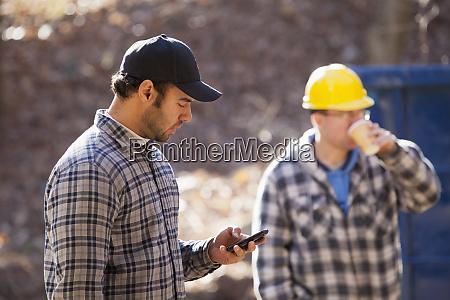 carpenter using a mobile phone at