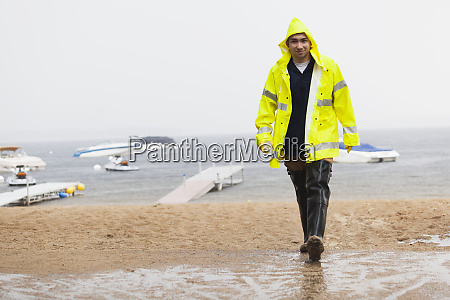 public works engineer carrying water sample