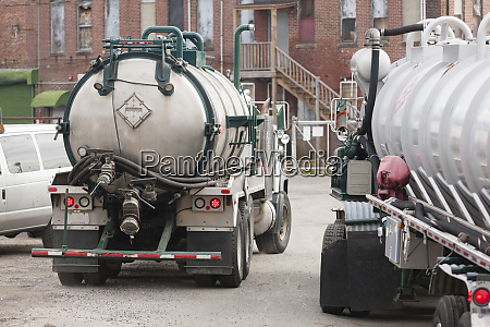 two hazardous waste tanker trucks for