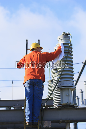 power engineer cleaning a fluid filled