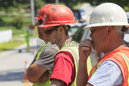 construction workers viewing project