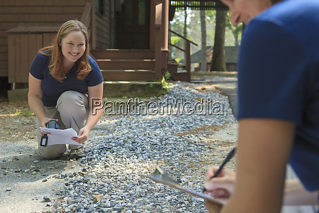 water quality engineers inspecting gravel run