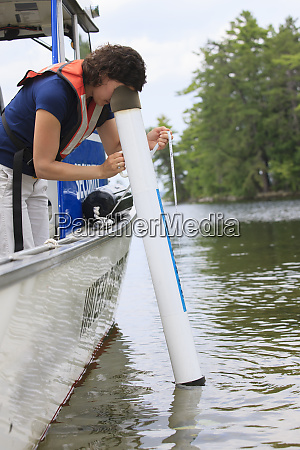 water treatment engineer using viewing tube