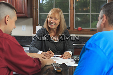 homeowner signing new service contract with