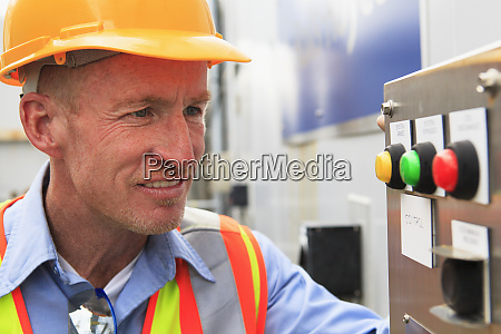 engineer at electric power plant examining