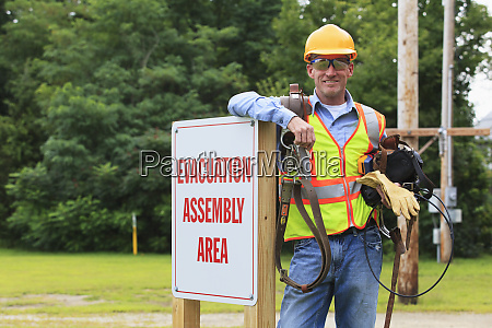 communications engineer with climbing equipment and