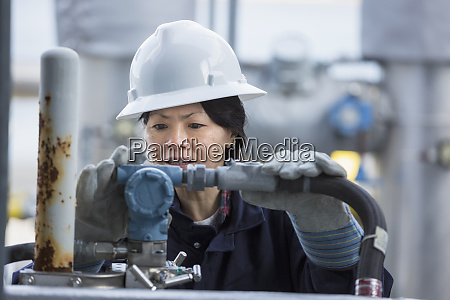 female power engineer checking transducer at