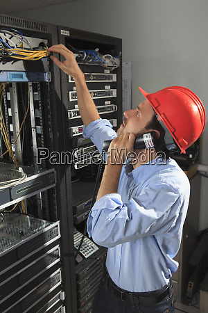 network engineer on phone performing trouble