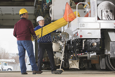 maintenance supervisors preparing to load shielding