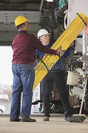 maintenance supervisors preparing to load barrier