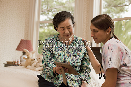 senior woman receiving a visit at