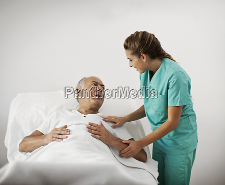 man in hospital receiving a visit