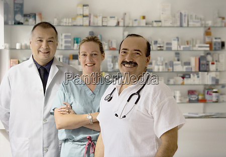 a team of three doctors smile