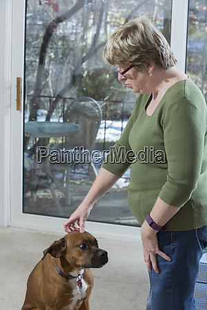 woman with autism standing with dog
