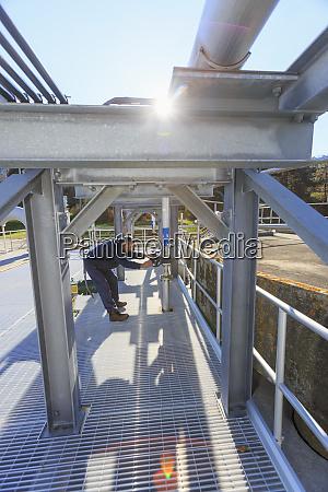 engineer adjusting flow control valve