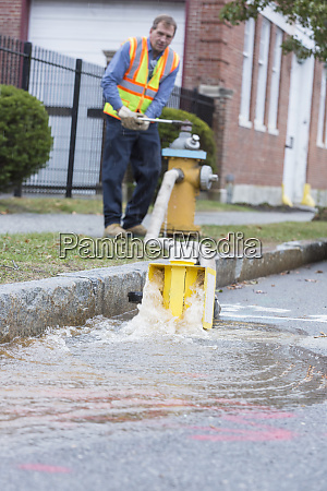 water department technician opening fire hydrant