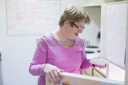 woman with autism holding a packet