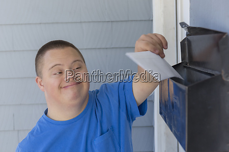 teen with down syndrome getting mail