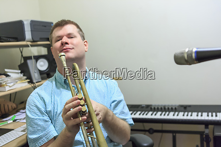 musician with visual impairment playing trumpet