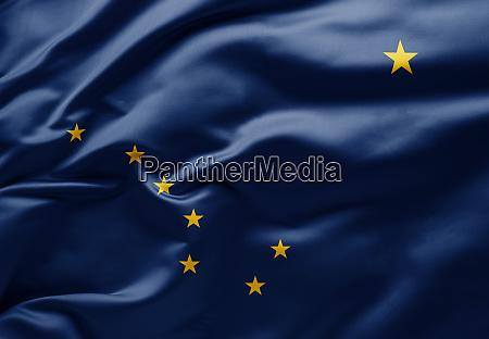 waving state flag of alaska