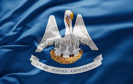 waving state flag of louisiana