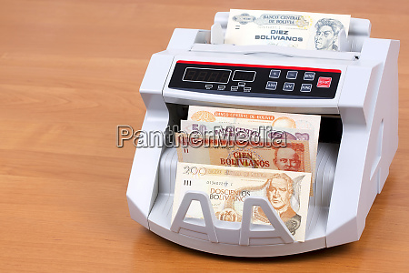 bolivian boliviano in a counting machine