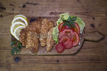 breaded chicken meat with salad and