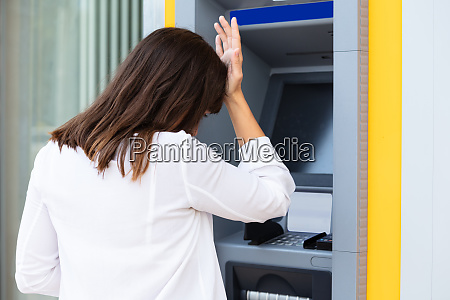 stressed woman looking at her bank