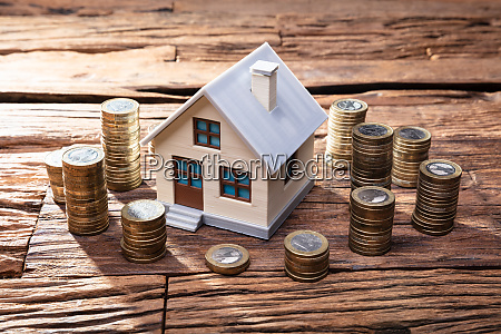 house model and stacked coins on