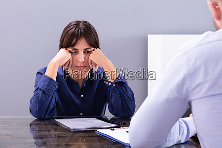 disappointed young woman sitting at interview