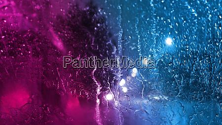 rain through the glass with neon