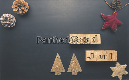 god jul on wooden blocks