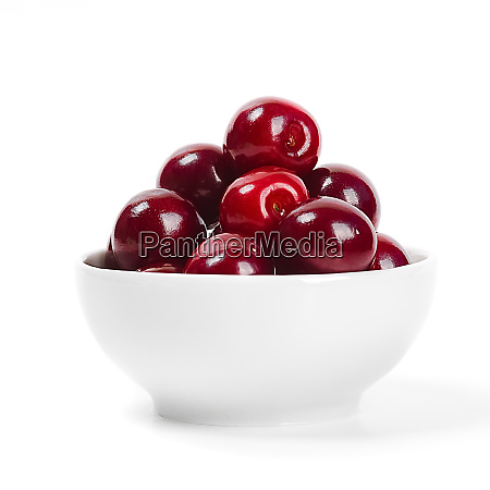 cherries in cup isolated on white